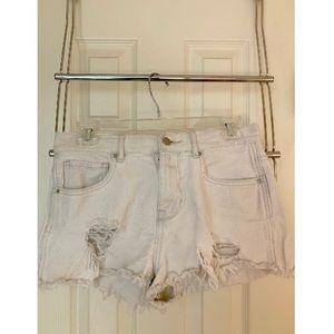 Women's distressed white jean shorts